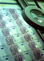 Euro banknotes under the magnigying glass