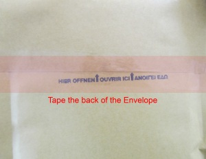 taping the envelope's opening